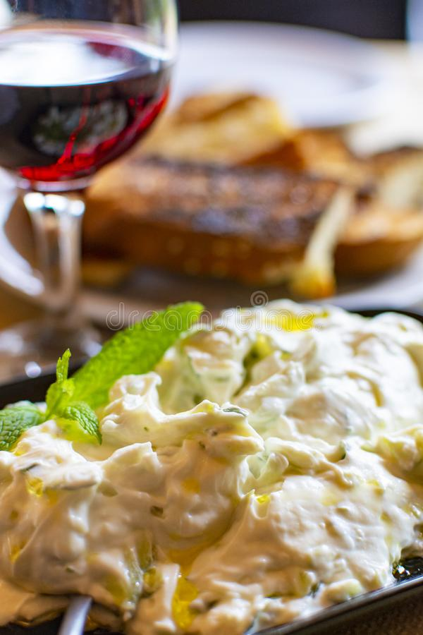 Tzatziki, cacik or tarator,  dip or sauce from Southeast Europe and Middle East made of salted strained yogurt mixed with. Cucumbers, garlic, salt, olive oil royalty free stock image