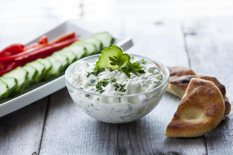 Tzatziki sauce with vegetable and pita bread stock images