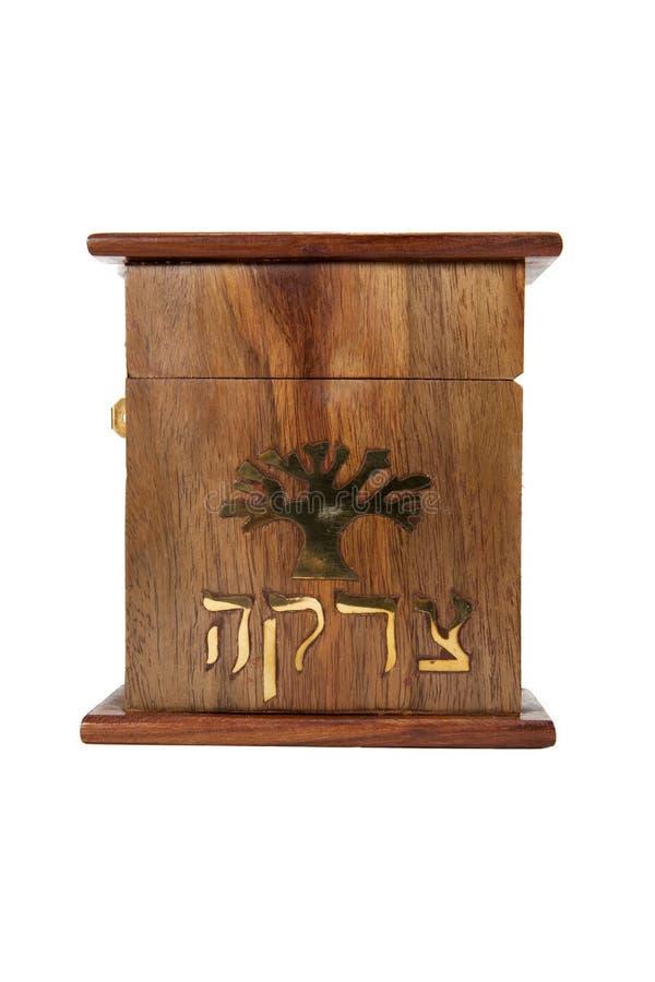 Tzedakah Box. A Tzedakah box against a white background royalty free stock image
