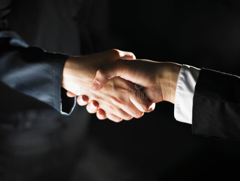 uścisk dłoni handshaking światło obraz stock