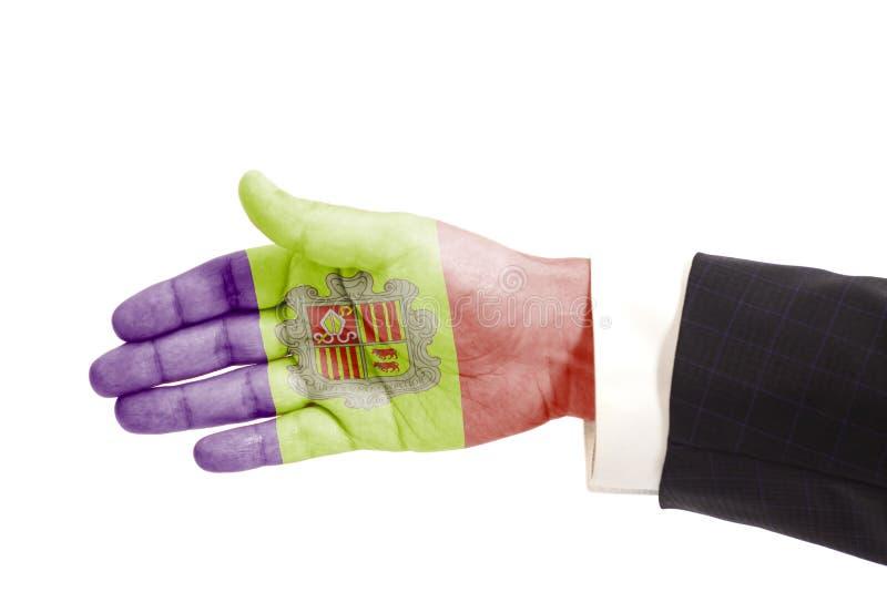 Uścisku dłoni gesta biznesmena ręka z Andorra flaga obraz royalty free