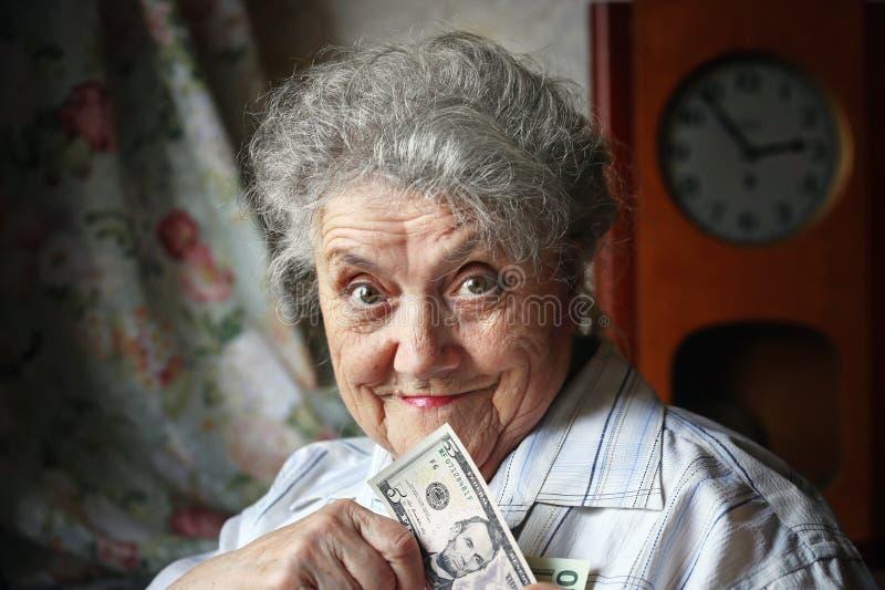 Uśmiech starsza kobieta z dolarami obrazy royalty free