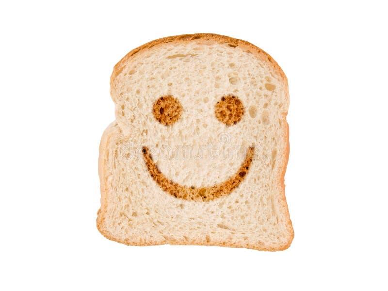 Uśmiech wznoszący toast na plasterku chleb, odizolowywającym na bielu obrazy stock