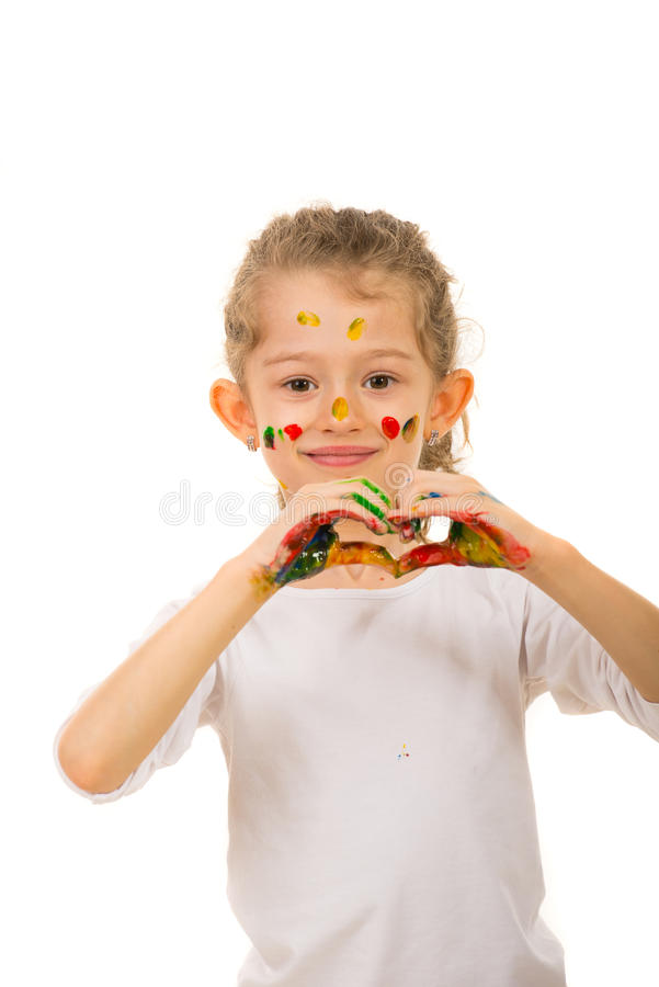 Uśmiechać się malującej dziewczyny pokazuje kierowego kształt zdjęcie royalty free