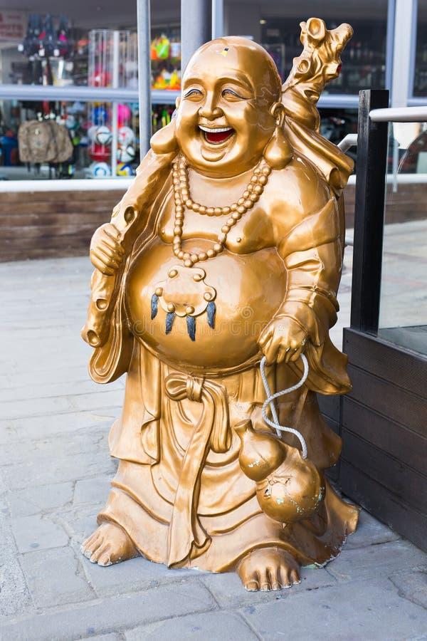 Uśmiechający się Buddha - Chiński bóg szczęście, bogactwo i Szczęsliwy na tle, zdjęcia royalty free