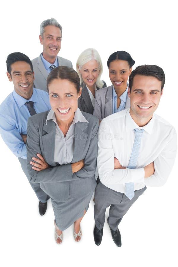 Uśmiechnięci ludzie biznesu patrzeje kamerę z rękami krzyżować zdjęcie royalty free