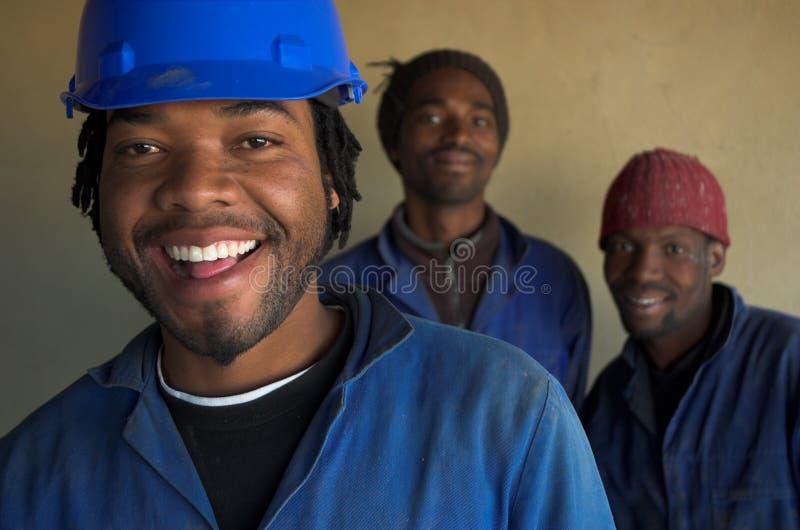 uśmiechnięci pracowników budowlanych fotografia royalty free
