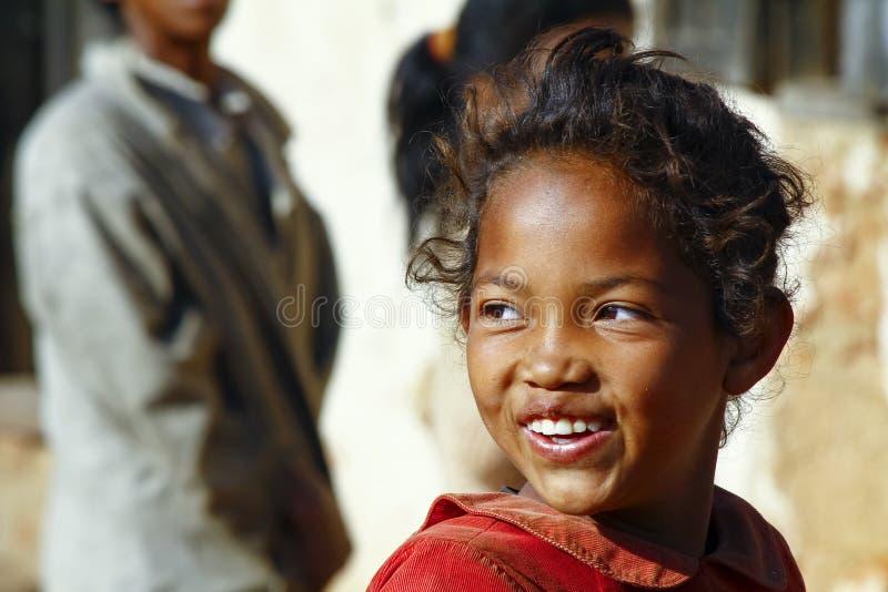 Uśmiechnięta biedna afrykańska dziewczyna, Afryka fotografia royalty free