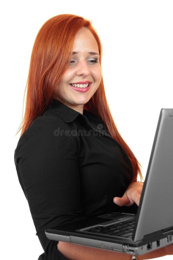 Uśmiechnięta biznesowa kobieta z laptopem obraz royalty free