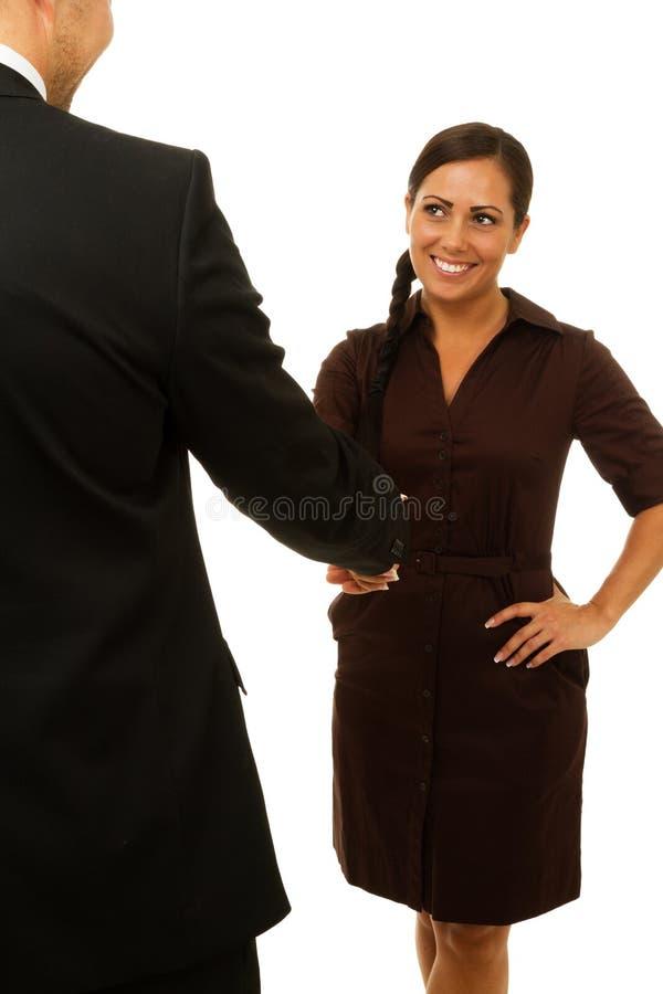 Uśmiechnięta biznesowej kobiety chwiania ręka zdjęcia royalty free