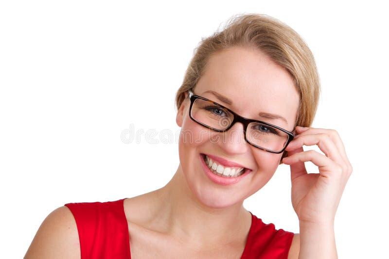 Uśmiechnięta blond kobieta z szkłami fotografia stock