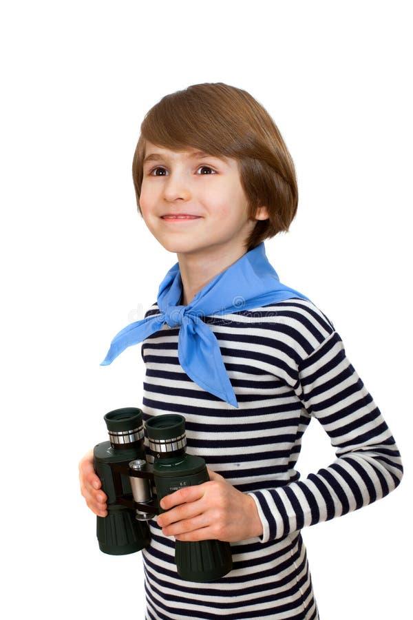 Uśmiechnięta chłopiec z obuocznym w pasiastej kamizelce zdjęcie royalty free
