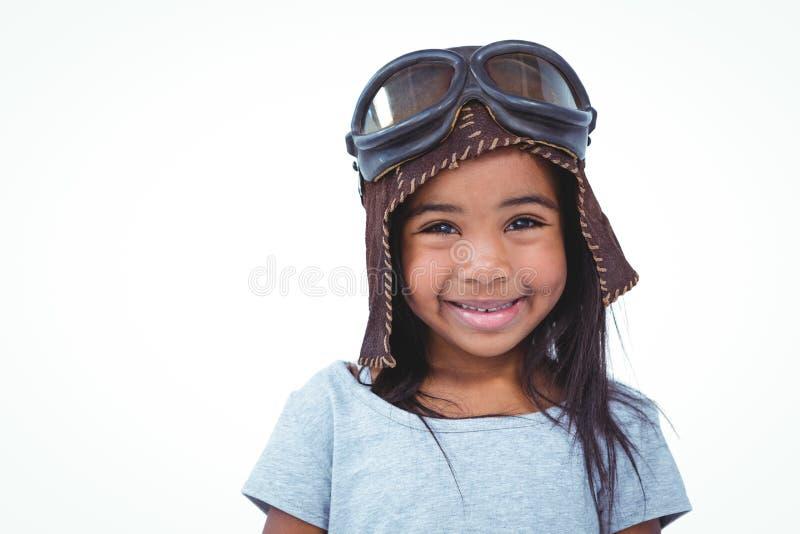 Uśmiechnięta dziewczyna udaje być pilotowy zdjęcia stock