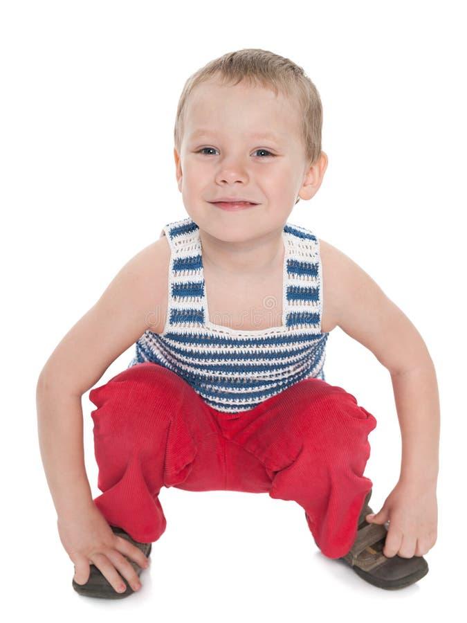 Download Uśmiechnięta Figlarnie Chłopiec Obraz Stock - Obraz złożonej z siedzi, pozytyw: 41951559