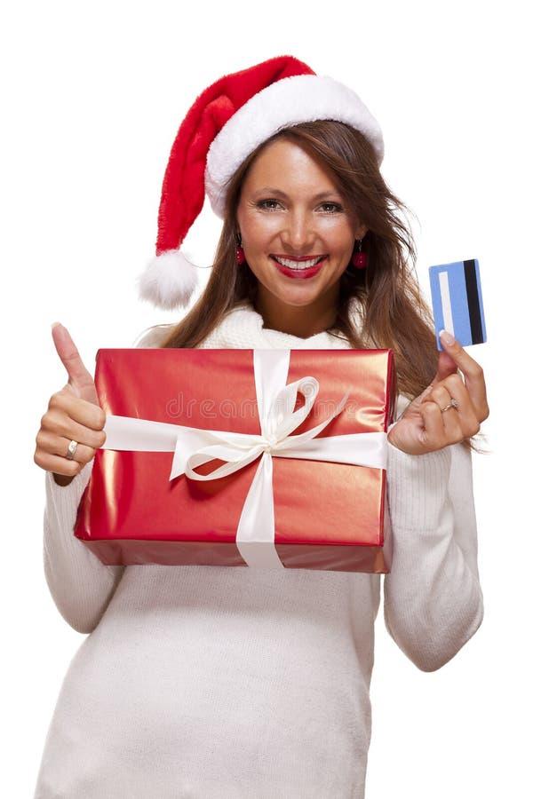 Uśmiechnięta kobieta nabywa Bożenarodzeniowych prezenty obrazy royalty free