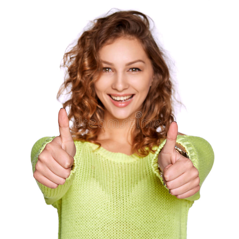 Uśmiechnięta kobieta pokazuje kciuk up zdjęcie royalty free