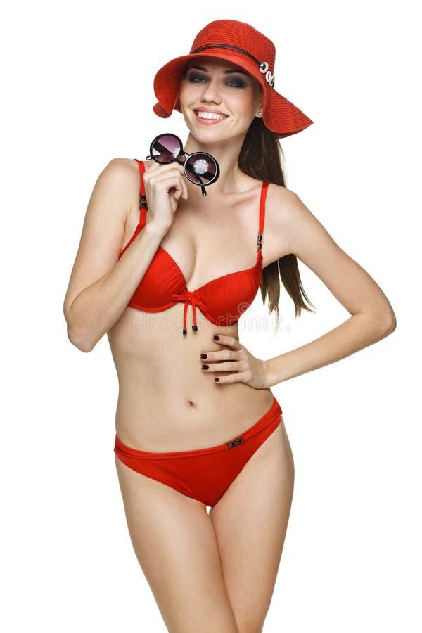 Uśmiechnięta kobieta w czerwonym bikini zdjęcie stock