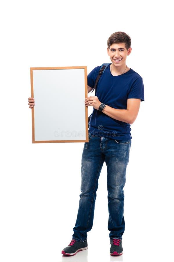 Uśmiechnięta męskiego ucznia mienia pustego miejsca deska zdjęcia stock