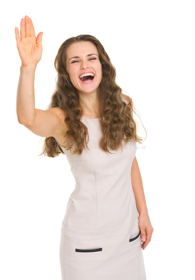 Uśmiechnięta młoda kobieta w smokingowy salutować zdjęcie royalty free