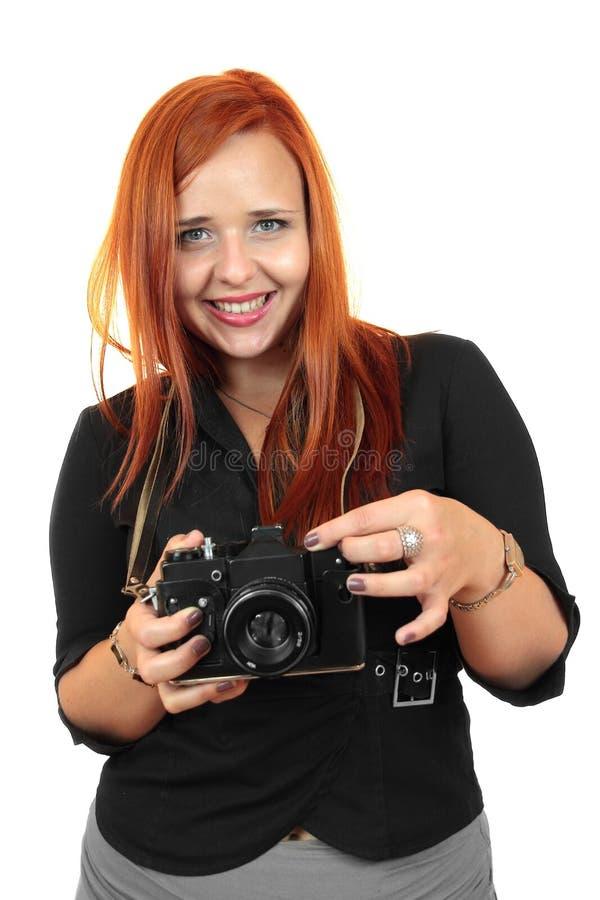 Uśmiechnięta młoda kobieta z starą kamerą zdjęcia stock