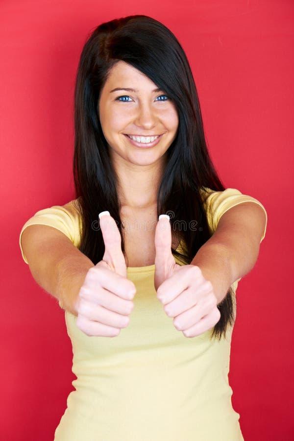 Uśmiechnięta pomyślna kobieta fotografia royalty free