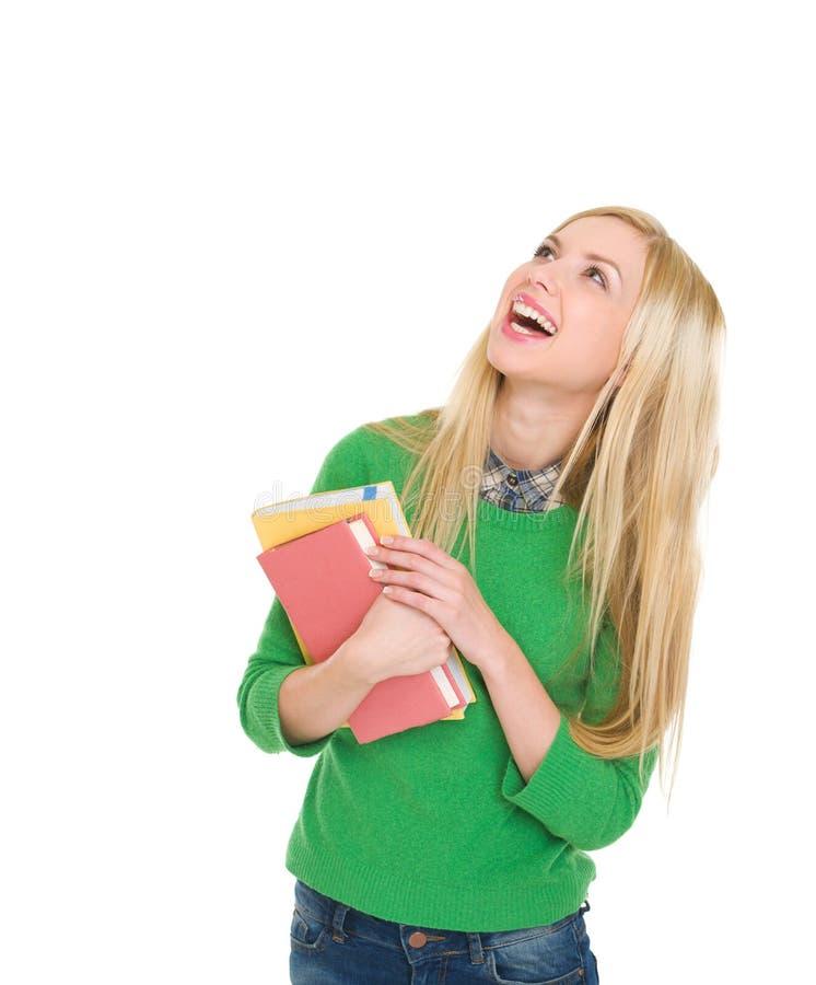 Uśmiechnięta studencka dziewczyna przyglądająca up na kopii przestrzeni zdjęcia stock