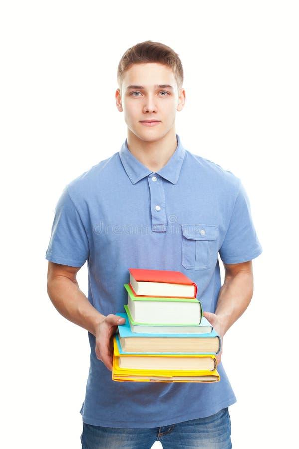 Uśmiechnięta studencka mienie sterta książki odizolowywać na bielu obrazy stock