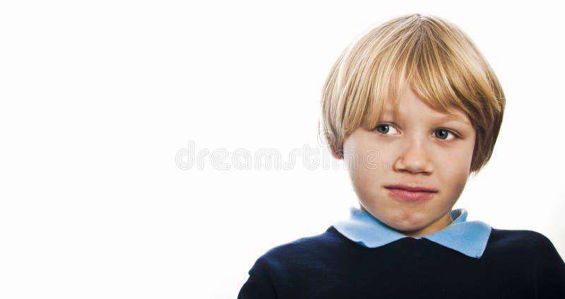 Uśmiechnięta szkolna chłopiec zdjęcia royalty free