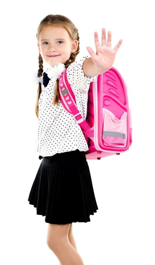 Uśmiechnięta uczennica mówi z plecakiem do widzenia zdjęcie royalty free