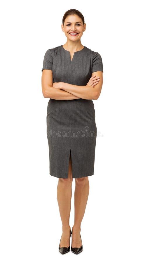 Uśmiechnięte bizneswoman pozyci ręki Krzyżować fotografia stock