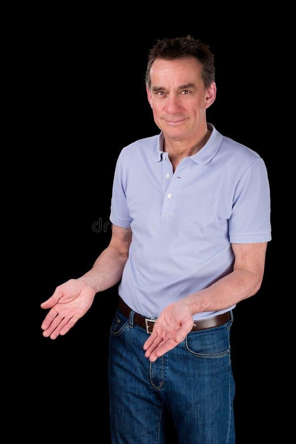 Uśmiechnięte mężczyzna ręki Posyłają Demonstrować Coś obrazy stock