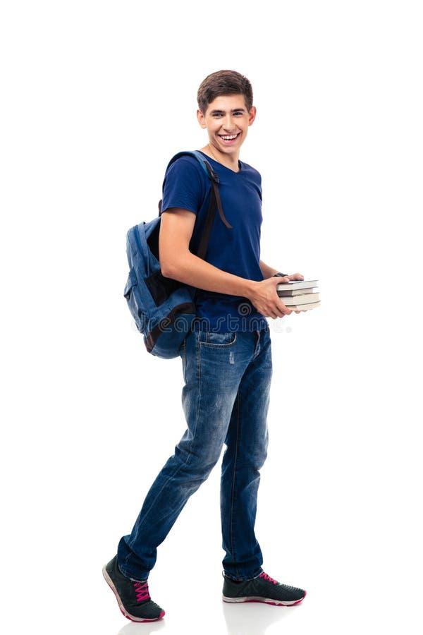 Uśmiechnięte męskiego ucznia mienia książki obraz stock
