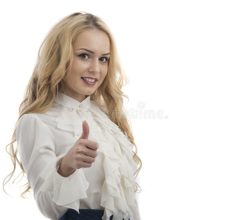 Uśmiechniętego biznesowej kobiety kciuka up przedstawienie. odosobniony biały tło obrazy stock