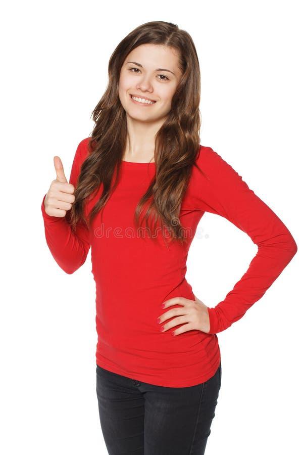 Uśmiechniętego kobieta kciuka up przedstawienie. Odosobniony tło. zdjęcia stock