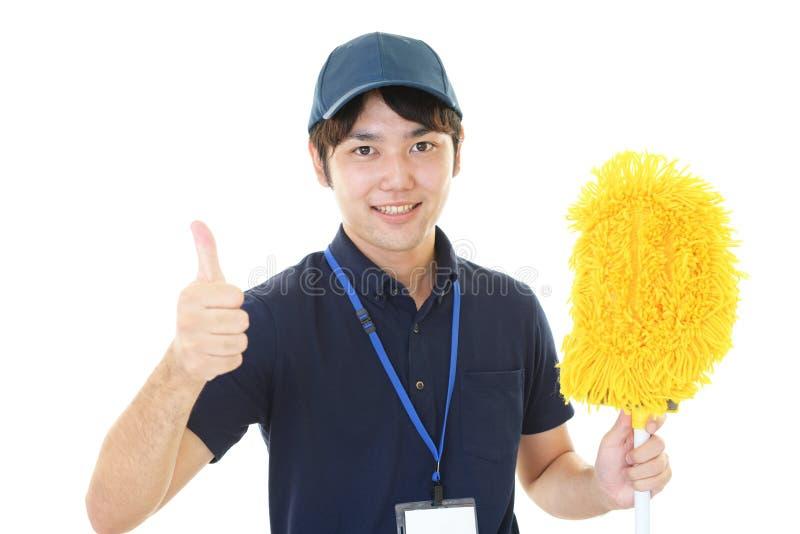 Uśmiechnięty Azjatycki janitor fotografia royalty free