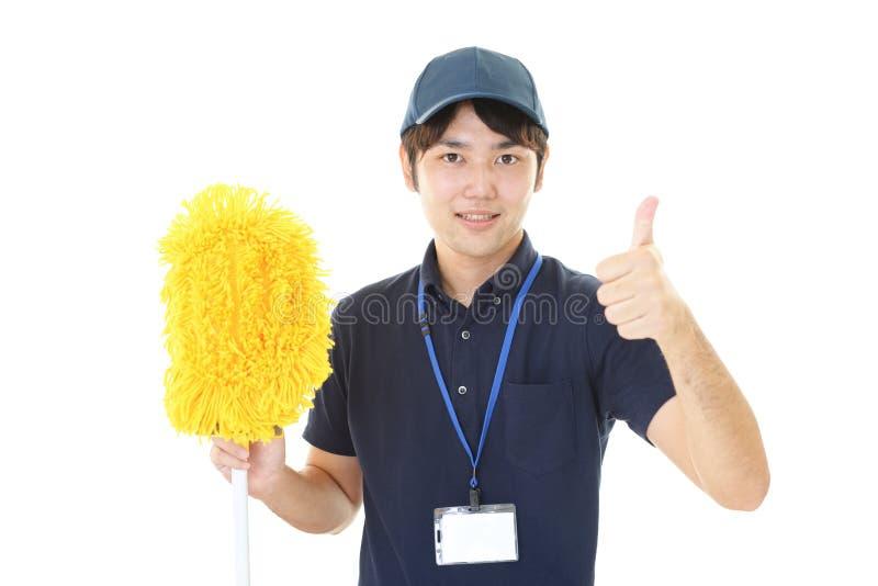 Uśmiechnięty Azjatycki janitor obraz royalty free