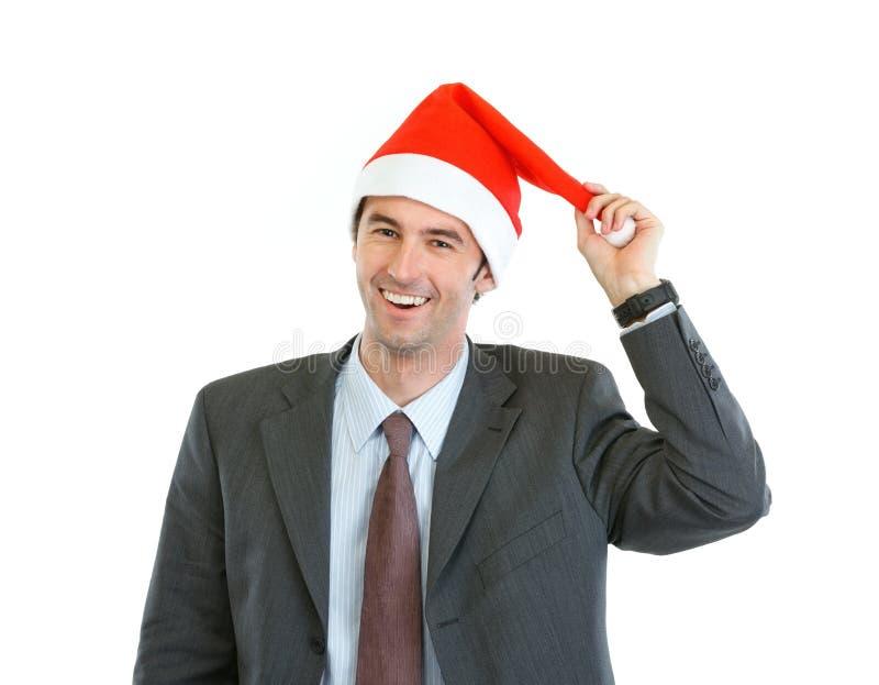 Uśmiechnięty biznesmen bawić się z Santas kapeluszowymi zdjęcia royalty free