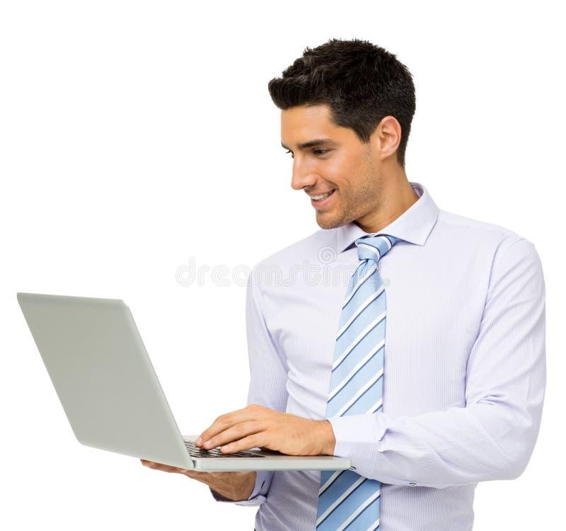 Uśmiechnięty biznesmen Używa laptop obraz stock
