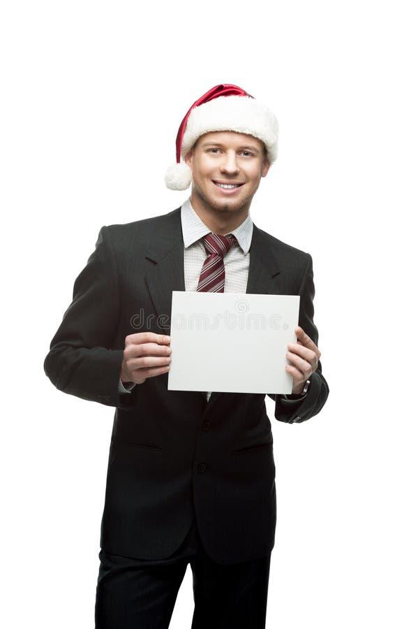 Uśmiechnięty biznesmen w Santa kapeluszowym mienia znaku obrazy royalty free