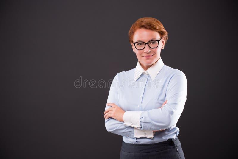 Uśmiechnięty businesslady w szkłach zdjęcia stock