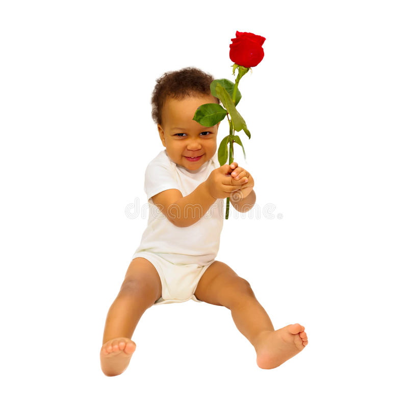 Uśmiechnięty czarny dzieciak daje kwiatu obrazy royalty free