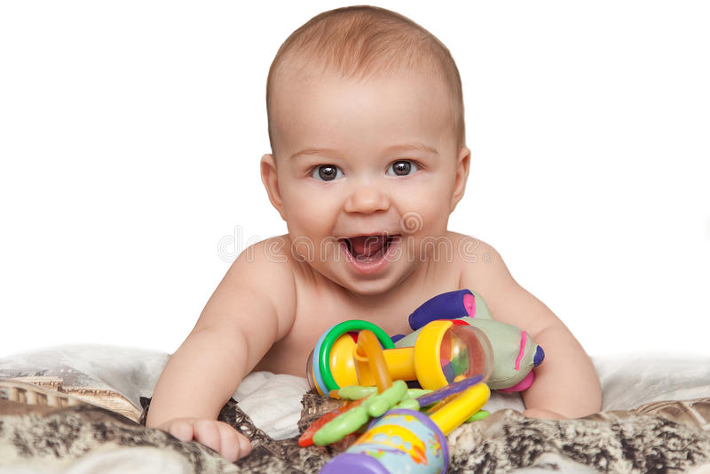 Uśmiechnięty dziecko z zabawkami zdjęcie royalty free