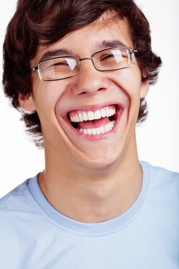 Uśmiechnięty facet w szkła zbliżeniu obraz stock