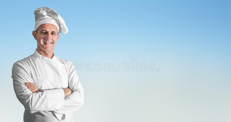 Uśmiechnięty kucharz na ligh tle obraz stock