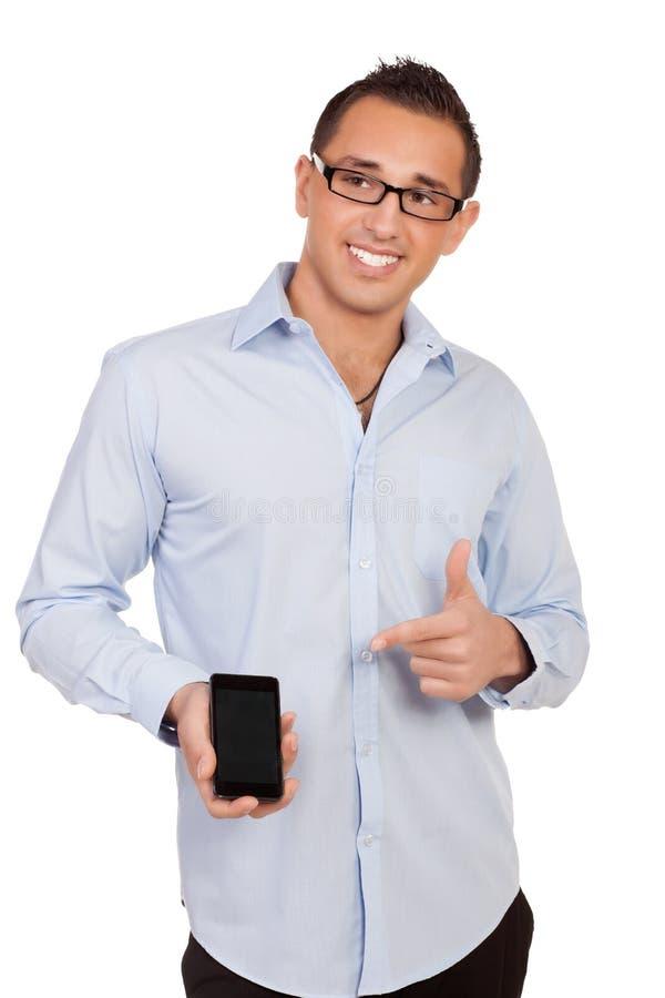 Uśmiechnięty mężczyzna wskazuje jego wisząca ozdoba fotografia royalty free