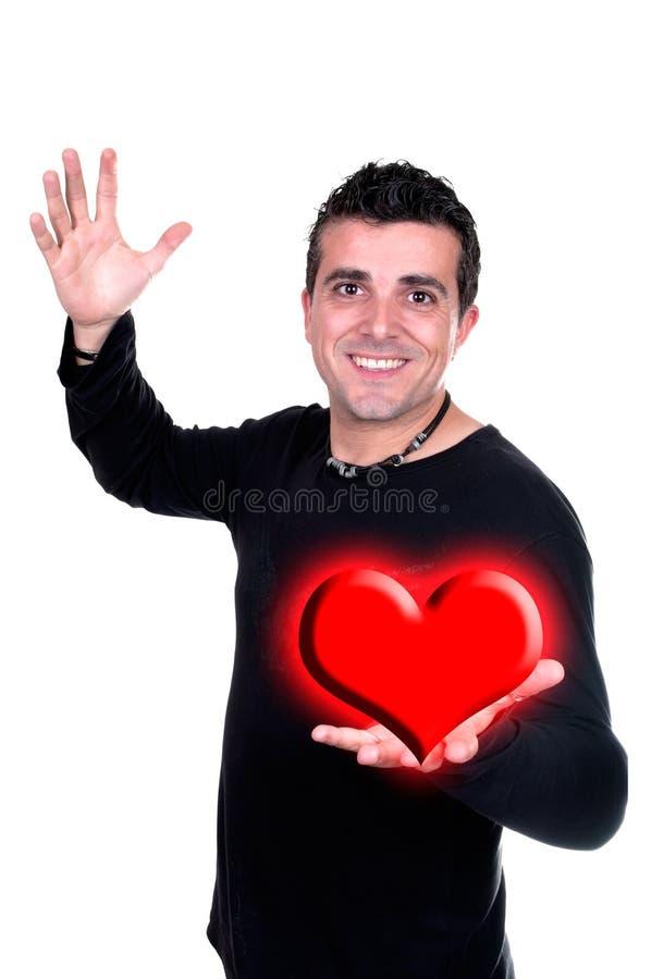 Uśmiechnięty mężczyzna z Valentin sercem w ręce zdjęcia stock
