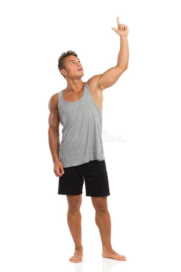 Download Uśmiechnięty Mięśniowy Młody Człowiek Wskazuje Up Zdjęcie Stock - Obraz złożonej z jeden, armada: 57669572