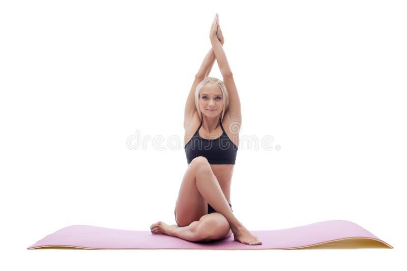 Uśmiechnięty spokojny joga trener odizolowywający na bielu zdjęcie stock