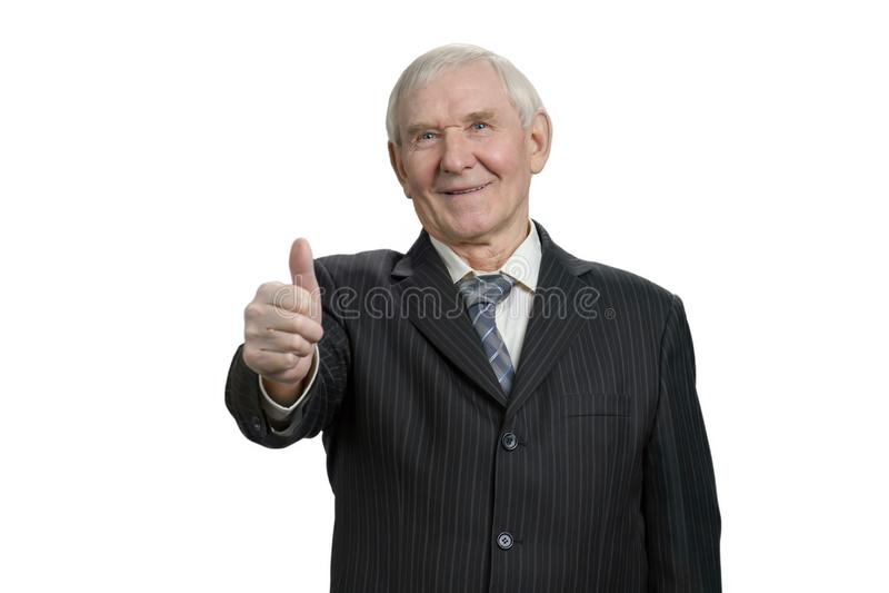 Uśmiechnięty stary biznesmen z kciukiem up obrazy royalty free