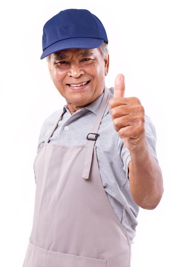 Uśmiechnięty szczęśliwy pracownik daje kciukowi w górę ręka gesta obrazy royalty free